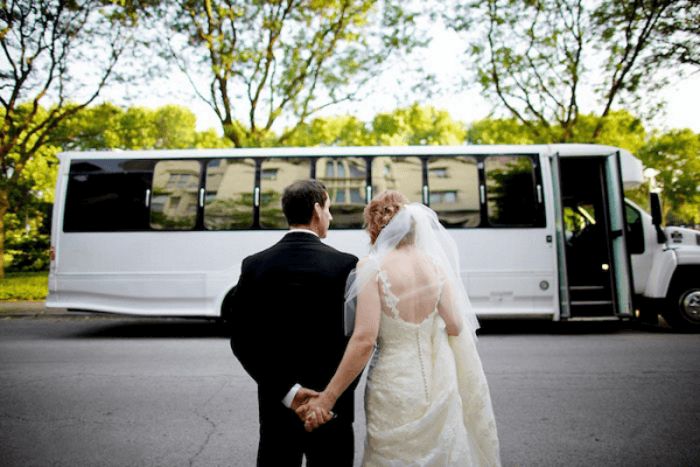 Image of a Bride and groom with bus