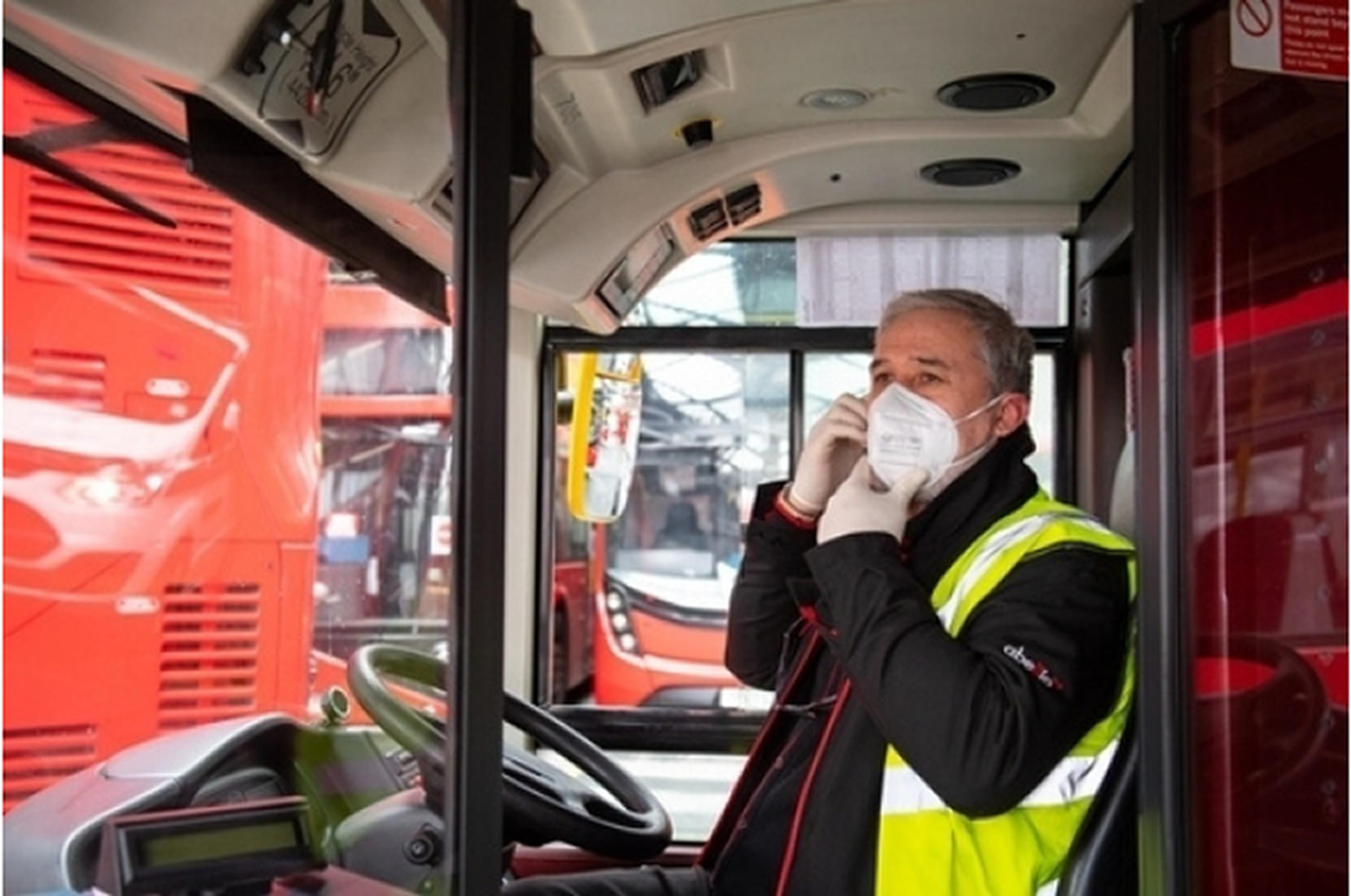 bus driver wearing mask for safety from covid